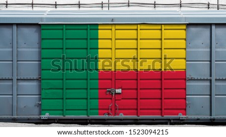 Front view of a container train freight car with a large metal lock with the national flag of Benin.The concept of export-import,transportation, national delivery of goods and rail transportation #1523094215