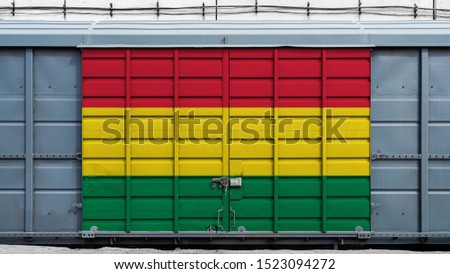 Front view of a container train freight car with a large metal lock with the national flag of Bolivia.The concept of export-import,transportation, national delivery of goods and rail transportation #1523094272