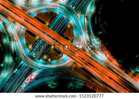 Aerial view of Smart transportation with Expressway, Road and Roundabout, busy highway traffic night time. Important infrastructure. #1523120777
