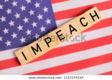Concept of US politics, Impeachment showing with US flag with Impeach in wooden letters. #1523144264