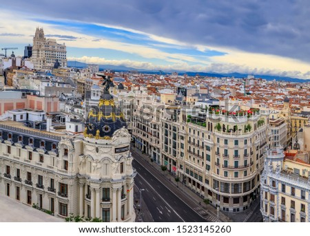 Madrid, Spain - June 4, 2017: Aerial view of Metropolis, one of the most beautiful buildings and Gran Via main shopping street with dramatic blue sky #1523145260