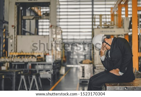 Entrepreneur feel Stressful depressed situation in factory.Unemployed Jobless People Crisis who Recession.Senior worker despair low economic crisis,business failure or government failed manage economy Royalty-Free Stock Photo #1523170304
