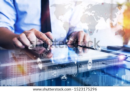 Double exposure of businessman using tablet factory with icon and data exchange in manufacturing technologies. Industry concept image. #1523175296