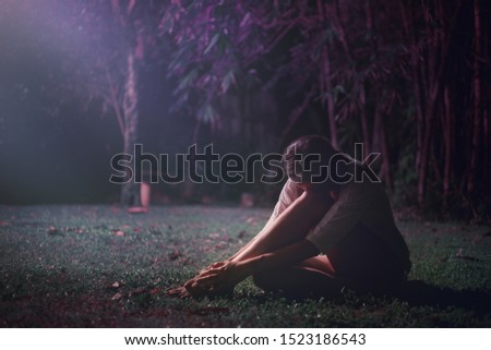 Young caucasian woman doing yoga at night in the tropical jungle. #1523186543