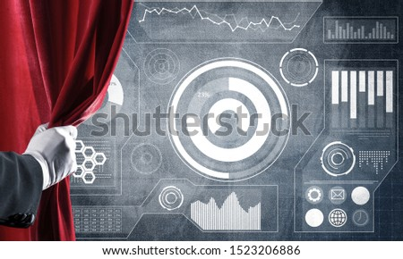 Hand opening red curtain and drawing business graphs and diagrams behind it #1523206886