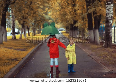 brother and sister under an umbrella in the park / boy and girl in the autumn park, walk in the woods children autumn #1523218091