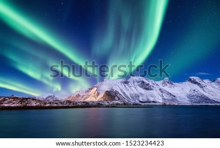 Aurora Borealis, Lofoten islands, Norway. Nothen light, mountains and ocean. Winter landscape at the night time. Norway travel - image #1523234423