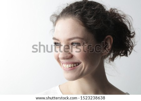 portrait of a young smiling woman #1523238638