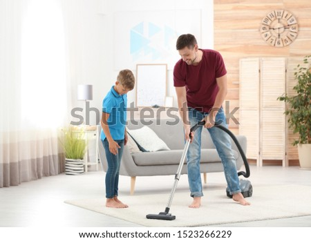 Dad and son cleaning living room together #1523266229