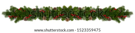 Christmas Border frame of tree branches red berries and pine cones on white background with copy space isolated #1523359475