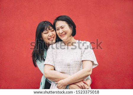 Happy Asian mother and daughter having fun outdoor - Chinese family people spending time together outside - Love, relationship and parenthood lifestyle concept #1523375018