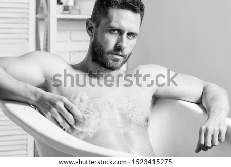 Cleaning parts body. Hygiene concept. Man muscular torso sit in bathtub. Skin care. Hygienic procedure concept. Total relaxation. Personal hygiene. Take care hygiene. Nervous system benefit bathing. #1523415275