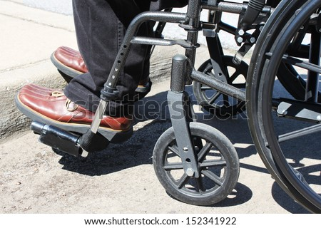 Person in a wheelchair with a curb in front #152341922