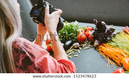 Food photography. Italian restaurant promotion. Female stylist shooting organic pasta ingredients.
