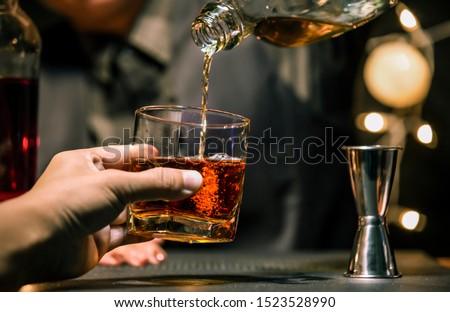 Bartender Serve Whiskey, on wood bar, #1523528990