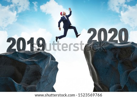 Businessman jumping from year 2019 to 2020 #1523569766