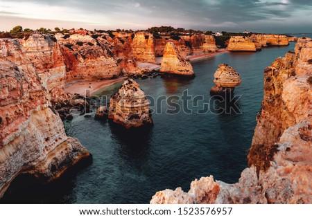 Idyllic beach and coast view at a calm morning with the rock sand stone nature landscape. Praia da Marinha, Famous Beach, Algarve Coast in South Portugal, Atlantic Ocean #1523576957