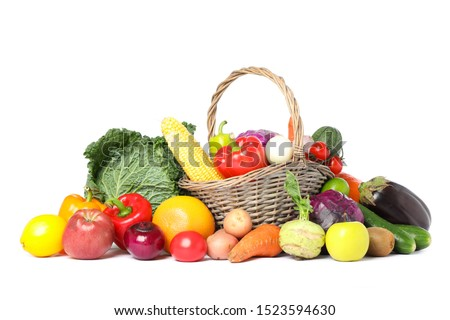 Wicker basket and different vegetables isolated on white background #1523594630