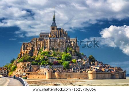 Beautiful panoramic view of famous Le Mont Saint-Michel tidal island with blue sky. Normandy, northern France #1523706056