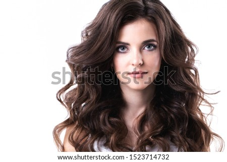 Portrait of beautiful girl with luxuriant hair curling. Health and Beauty. #1523714732