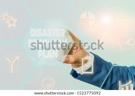 Handwriting text Disaster Recovery Plan. Concept meaning having backup measures against dangerous situation Male human wear formal work suit presenting presentation using smart device. #1523775092
