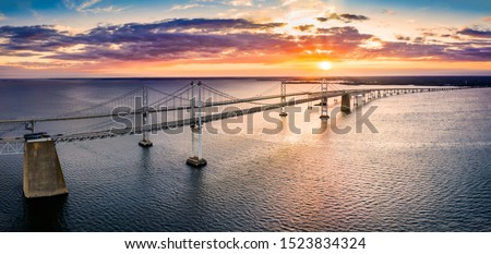 Aerial panorama of Chesapeake Bay Bridge at sunset. The Chesapeake Bay Bridge (known locally as the Bay Bridge) is a major dual-span bridge in the U.S. state of Maryland. #1523834324