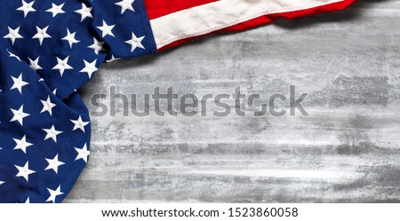 US American flag on worn white wooden background. For USA Memorial day, Veteran's day, Labor day, or 4th of July celebration. With blank space for text. #1523860058