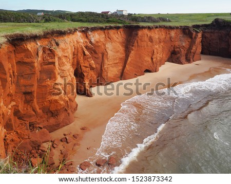 Red cliffs  and beach, houses on top, landscape of Belle Anse, Magdalen islands, Quebec, Canada #1523873342