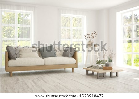Stylish room in white color with sofa and summer landscape in window. Scandinavian interior design. 3D illustration #1523918477