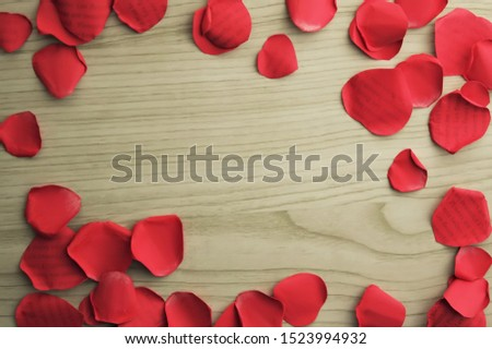 "rose petals made of papaer frame on wood background  (""Les fleurs sont belles"" is ""Flowers are beautiful""in French"" ) #1523994932"