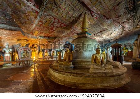 Dambulla historical cave temple in Sri Lanka Royalty-Free Stock Photo #1524027884