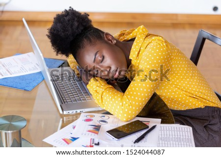 Tired overworked woman resting while she was working writing notes. Overworked and tired businesswoman sleeping over a laptop in a desk at home. Tired businesswoman #1524044087