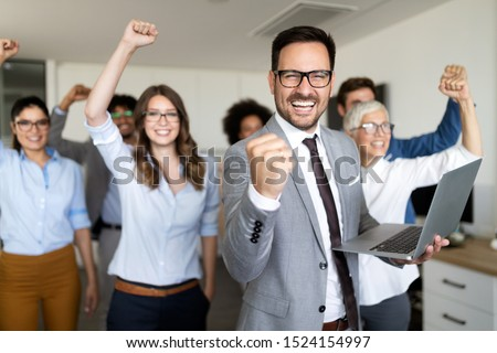 Successful company with happy workers in office #1524154997