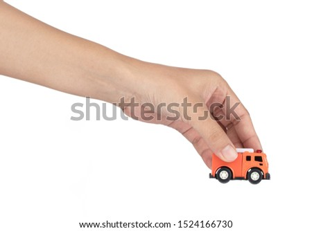 hand holding toys fire truck isolated on a white background.