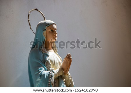 A picture of the Holy Mary statue in a church in Poland.
