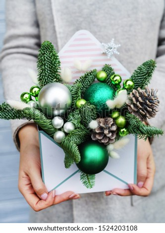 Christmas bouquet in the hands #1524203108