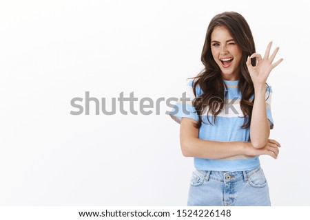 Assured ambitious lovely female entrepreneur self-assured looking confident, wink and smiling motivated show okay ok, no problem sign, give positive feedback, like idea, judging cool product #1524226148