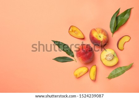 Flat lay composition with sweet juicy peaches and space for text on orange background #1524239087