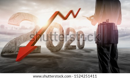 The economic crisis of 2020. Red arrows fall to the ground, indicating the economic recession that will occur in 2020. Royalty-Free Stock Photo #1524251411