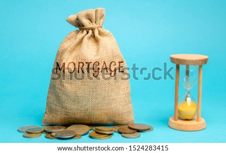 Money bag with the word Mortgage and hourglass. Mortgage rates concept. Loan and credit. Interest payment. Business and finance. Real estate, housing #1524283415