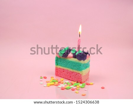 Happy birthday cake and bow candle on pink background with copy space. Birthday party concept background #1524306638