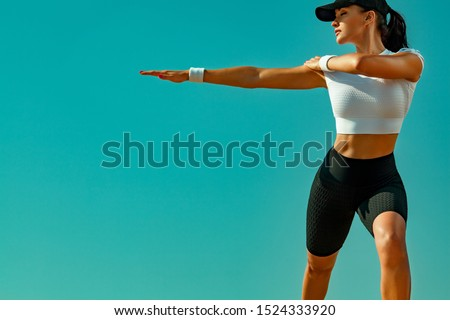 Sporty and fit young woman athlete doing yoga training on the sky background. The concept of a healthy lifestyle and sport. Individual sports recreation. #1524333920