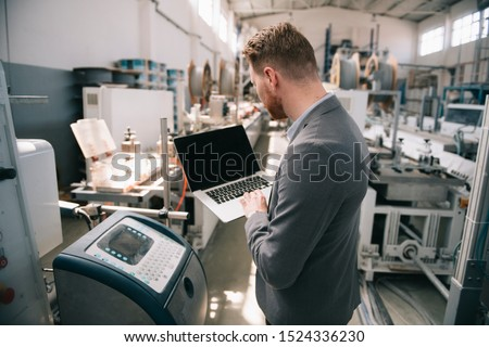 Factory manager in inspection of manufacturing. Man in Industrial Environment. - Image #1524336230