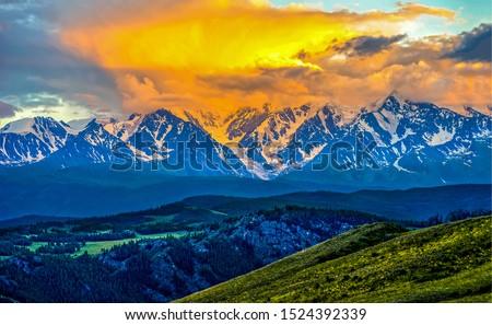 Mountain peak snow sunset sky landscape. Sunset sky mountain peaks. Mountain peaks sunset sky clouds. Sunset mountain landscape #1524392339