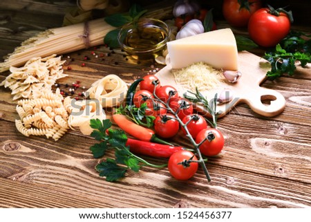 On holiday preparing food for Lunch with my family going to fry pasta with olive oil, cheese, spicy chilli and tomatoes before cooking taking photo of all ingredients. #1524456377