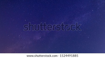 Panorama blue night sky milky way and star on dark background.Universe filled with stars, nebula and galaxy with noise and grain.Photo by long exposure and select white balance.selection focus.amazing #1524491885