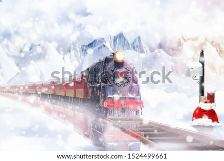 Christmas Express in the snowy landscape brings gifts Royalty-Free Stock Photo #1524499661