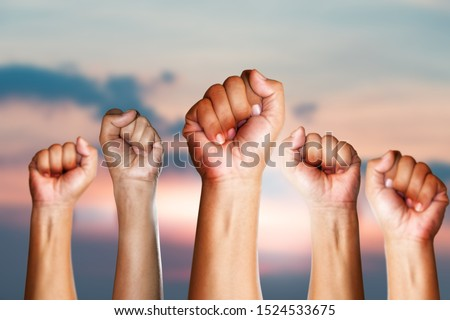 Teamwork concept,Peoples raised fist air fighting, Competition, background space for text. #1524533675