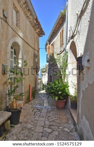 Province of Avellino, Italy, 09/28/2019. A narrow street among the old houses of a medieval village. The architectural style is typically Mediterranean. #1524575129