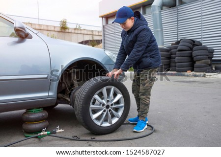 Children's mechanic to replace the wheel tires and service the vehicle suspension. The concept of repair. #1524587027